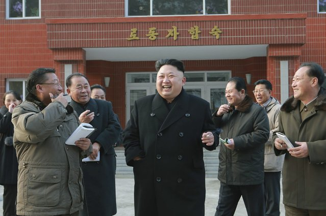 North Korean leader Kim Jong Un (C) laughs during his visit to the Kangdong Precision Machine Plant in this undated photo released by North Korea's Korean Central News Agency (KCNA) in Pyongyang January 16, 2015. (Photo by Reuters/KCNA)