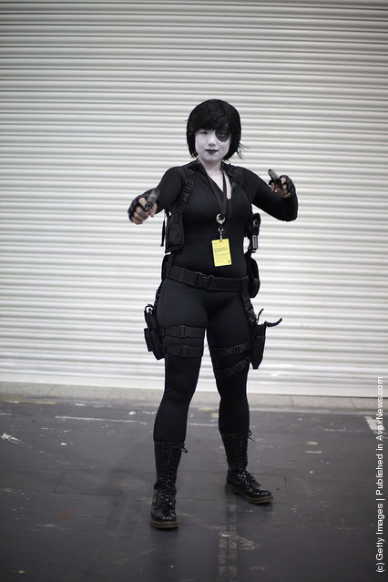 A visitor to the London Super Comic Convention dresses as Domino at ExCel