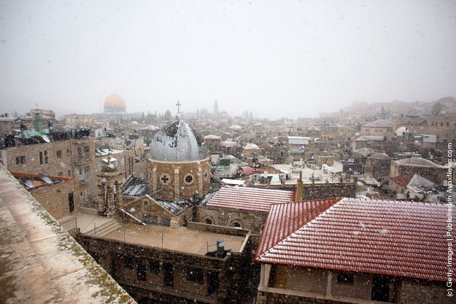 Snow dusts roofs as it falls over the old city houses on March 2, 2012 in Jerusalem, Israel