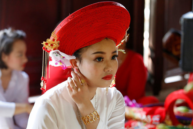 Medium Pham Ha Thanh prepares for her performance at a Hau Dong ceremony at Chau De Tu temple in Thanh Hoa province in Vietnam, May 15, 2017. (Photo by Reuters/Kham)