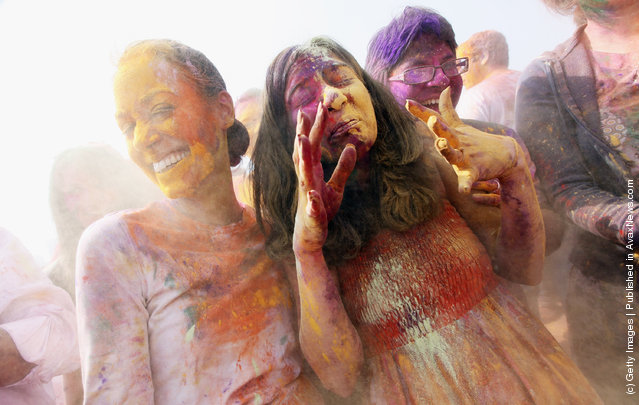 Revelers celebrate the Indian festival of Holi on a boat cruise around part of Manhattan