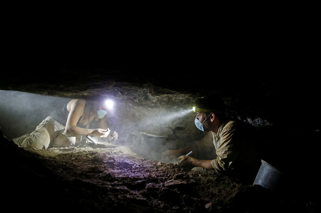 Volunteers with the Israeli Antique Authority work inside the Cave of the Skulls, an excavation site in the Judean Desert near the Dead Sea, Israel June 1, 2016. (Photo by Ronen Zvulun/Reuters)