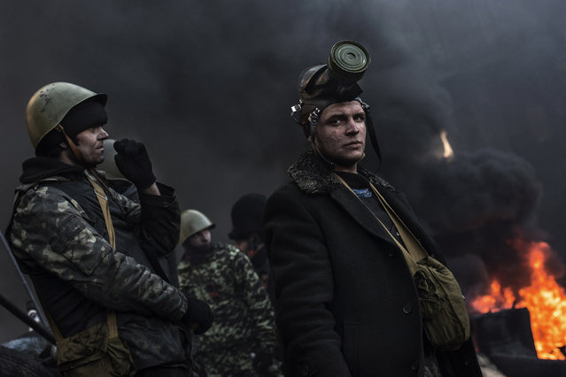 """""""Mad Max"""". Anti-government protesters observe the activity of riot police from the top of barricades in Hrushveskoho Street. Photo location: Kiev, Ukraine. (Photo and caption by Giorgio Bianchi/National Geographic Photo Contest)"""