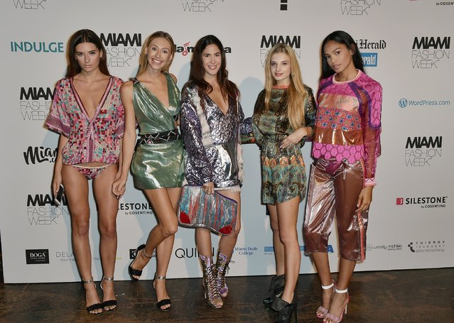 Models pose backstage at the Custo Barcelona Show during Miami Fashion Week at Ice Palace Film Studios on June 2, 2017 in Miami, Florida. (Photo by Gustavo Caballero/Getty Images for Miami Fashion Week)