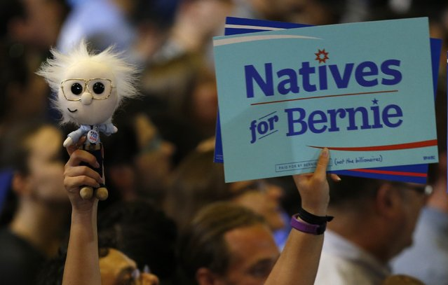 A supporter holds a sign and a Sanders doll while awaiting an appearance by Democratic U.S. presidential candidate Bernie Sanders following the closing of the polls in the California presidential primary in Santa Monica, California, U.S., June 7, 2016. (Photo by Mario Anzuoni/Reuters)