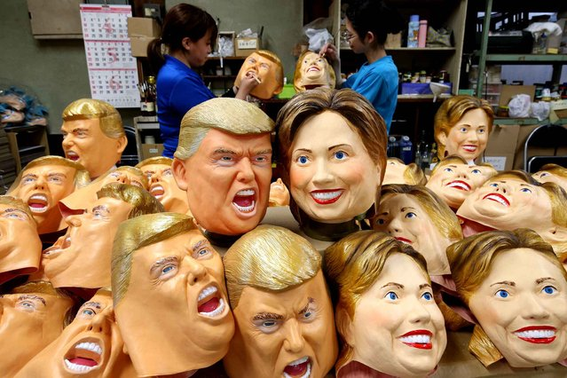 Workers of Ogawa Rubber Inc. are making rubber masks of U.S. Presidentail Republican Donald Trump and his Democratic counterpart Hillary Clinton at its factory in Omiya, Saitama Prefecture on June 9, 2016. Trump and Clinton have run their face deadheat race. (Photo by The Yomiuri Shimbun via AP Images)