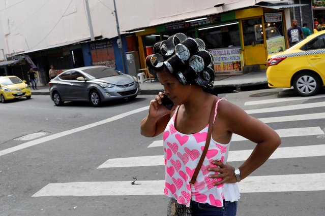 A woman talks on her mobile phone in Panama City, Panama on April 30, 2019. (Photo by Carlos Jasso/Reuters)