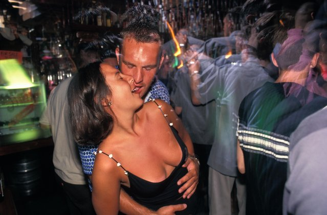 Couple dancing at a nightclub in San Antonio, Ibiza, Spain. (Photo by Alamy Stock Photos)