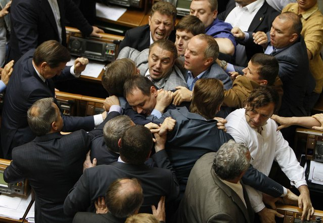 A fight breaks out in the Ukraine parliament in Kiev between members of the Svoboda Party and the Regions Party during discussion of a presidential decree to call up additional military reserves to its border with Russia, on July 22, 2014. (Photo by Alex Kuzmin/Reuters)