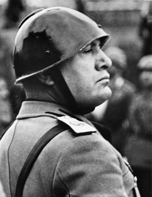 Italian Premier-dictator Benito Mussolini reviews troops before the national Italian monument in honor of the 68th birthday of King Victor Emmanuel in Rome, Italy, November 11, 1937. (Photo by AP Photo)