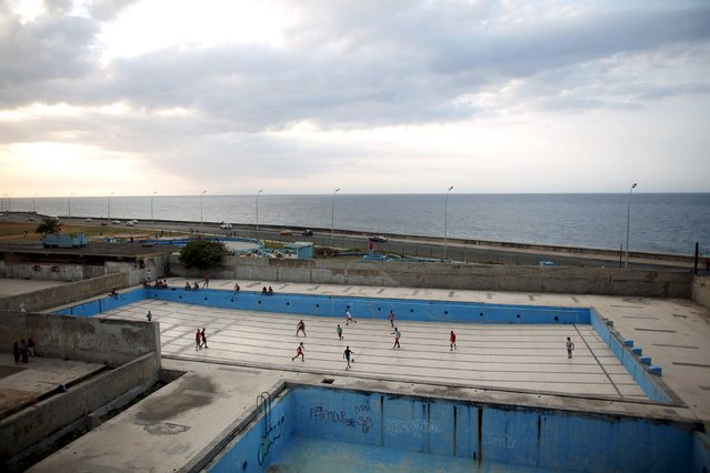 Youths play soccer in an empty swimming pool at a park in Havana, March 13, 2015. (Photo by Alexandre Meneghini/Reuters)