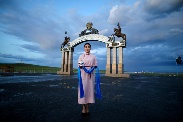 A girl poses for a photo in Khentii, Mongolia on August 14, 2019. Khentii is best known as the birthplace and likely final resting place of Genghis Khan. Families living in the steppes in the region continue their centuries-old tradition and lifestyle. (Photo by Firat Yurdakul/Anadolu Agency via Getty Images)