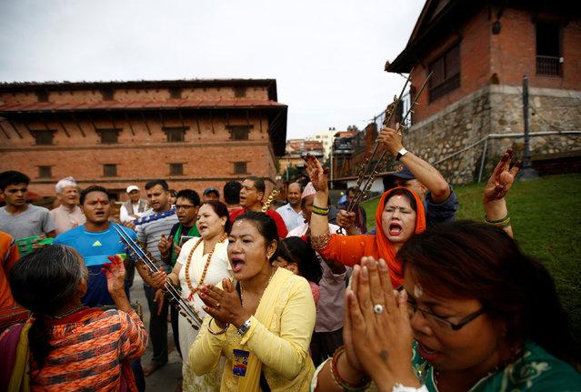Devotees sing and dance at Pashupatinath temple to mark the Shrawan Sombar festival in Kathmandu, Nepal, July 18, 2016. (Photo by Navesh Chitrakar/Reuters)