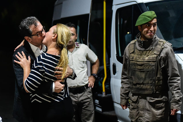 Kadri Gursel, a columnist for Turkey's main opposition newspaper Cumhuriyet, kisses his wife Nazire Kalkan Gursel after his release from Silivri prison outside Istanbul, early Tuesday, September 26, 2017. A court in Istanbul has ordered Gursel released from prison pending the conclusion of his trial. The court on Monday ruled that four other Cumhuriyet newspaper employees, including editor-in-chief Murat Sabuncu and investigative journalist Ahmet Sik, remain in pre-trial detention. (Photo by Yasin Akgul/AFP Photo)