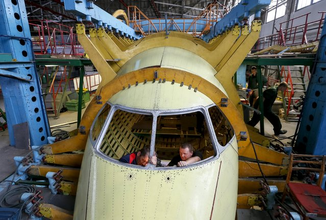 Workers work inside a new Antonov airplane at the Antonov aircraft plant in Kiev, Ukraine, September 7, 2015. (Photo by Gleb Garanich/Reuters)