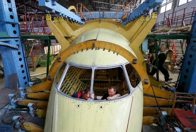 Workers work inside a new Antonov airplane at the Antonov aircraft plant in Kiev, Ukraine, September 7, 2015. (Photo by Gleb Garanich/Reuters)