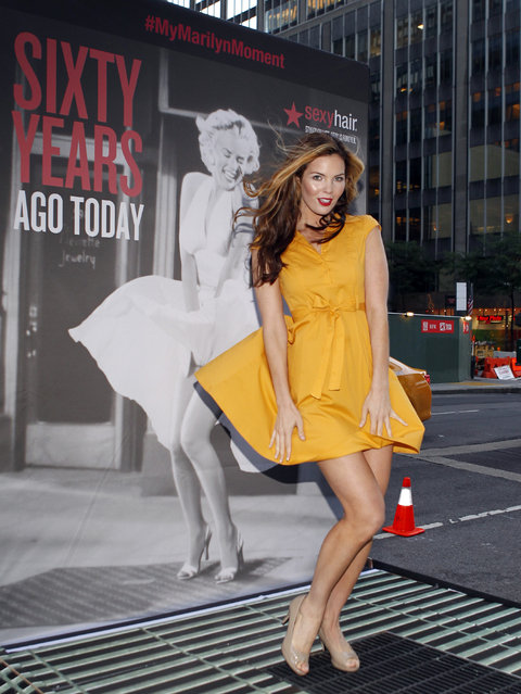s*xy Hair celebrates the 60th anniversary of the scene-stealing moment when Marilyn Monroe's dress is lifted by a gust of wind from the subway during the filming of The Seven Year Itch by recreating the iconic scene on the streets of New York, Monday, September 15, 2014.  (Photo by Jason DeCrow/Invision for s*xy Hair/AP Images)