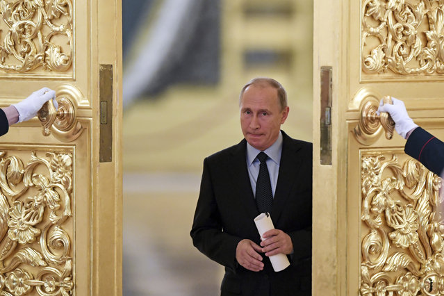 Russian President Vladimir Putin enters a hall to meet members of the Presidential Council for Civil Society and Human Rights at the Kremlin, in Moscow, Russia, Monday, October 30, 2017. (Photo by Kirill Kudryavtsev/Pool photo via AP Photo)