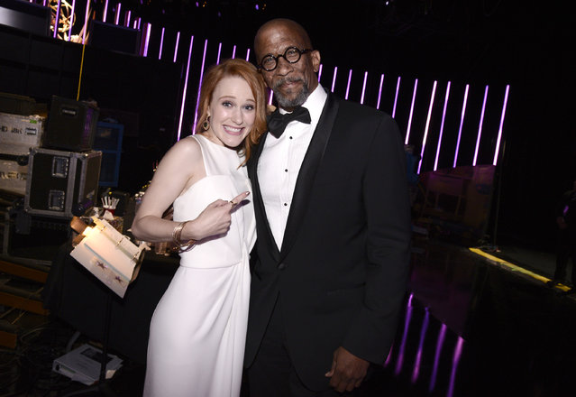 Rachel Brosnahan, left, and Reg E. Cathey pose backstage at the Television Academy's Creative Arts Emmy Awards at Microsoft Theater on Saturday, September 12, 2015, in Los Angeles. (Photo by Dan Steinberg/Invision for the Television Academy/AP Images)