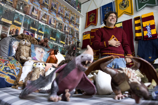 Menahem Asher Silva Vargas, a 37 year old lawyer, smiles as he shows off his collection of Harry Potter memorabilia, after being awarded the Guinness World Record title for the largest collection, in Mexico City, Monday, September 29, 2014. (Photo by Rebecca Blackwell/AP Photo)