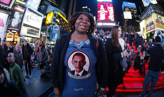 Marta Nunez from Honduras wears a Barack Obama dress as she watches TV screens in Times Square giving U.S presidential election results in New York November 6, 2012. (Photo by Carlo Allegri/Reuters)