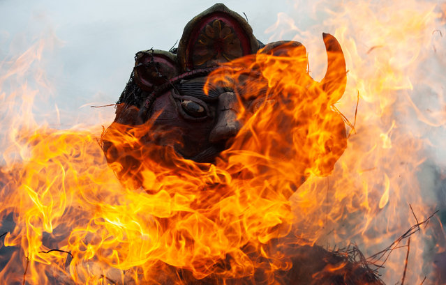 Peoples burn an effigy of mythical demon Ghanta Karna during the Ghantakarna festival amid the outbreak of the coronavirus disease (COVID-19) on July 19, 2020. Peoples believed that the festival wards off evil spirits, and brings peace and prosperity in their lives. In this festival, people worship and offer sacrifices to demons and supernatural power. (Photo by Prabin Ranabhat/SOPA Images)