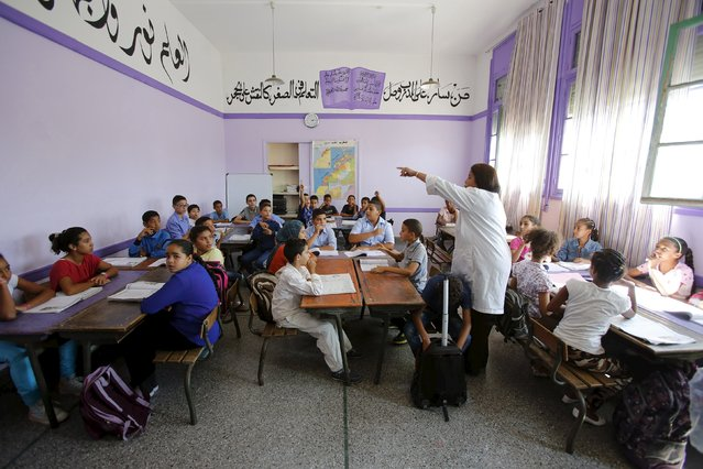 Schoolchildren listen to a teacher as they study during a class in the Oudaya primary school in Rabat, September 15, 2015, at the start of the new school year in Morocco. (Photo by Youssef Boudla/Reuters)