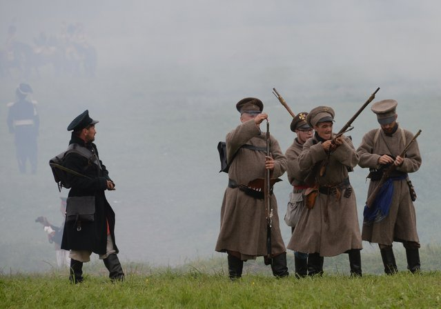 Participants in the military historical reconstruction of the Battle of Borodino during the show in Borodino Field, Moscow Region on September 4, 2016. (Photo by Kirill Kallinikov/Sputnik)