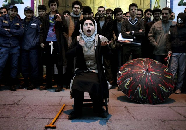 "Iranian actress Elaheh Pourjamshid performs her role as a mother in ""Awakening of The Particles"" street theater, telling a story about children's education, during the 31st Fajr International Theater Festival in Tehran, January 17, 2013. The Fajr festival is the most important theatrical event in the country and marks the anniversary of the 1979 Islamic revolution. (Photo by Vahid Salemi/Associated Press)"