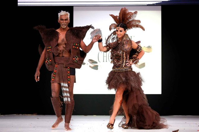 Ludivine Sagna and Satya Oblet walk the runway and wears a chocolate costume made by designer and a chocolate maker during the Fashion Chocolate show at Salon du Chocolat at Parc des Expositions Porte de Versailles in Paris, France, October 28, 2014. (Photo by LAURENTVU/SIPA Press)