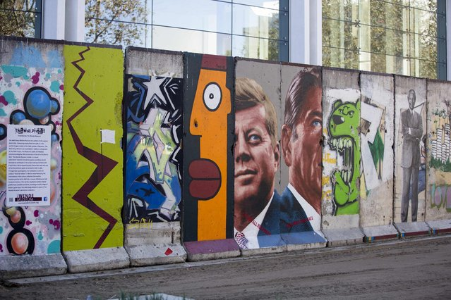 Ten segments of the Berlin Wall, which constitute the longest stretch outside of Berlin, are seen on display in Los Angeles, California September 18, 2014. (Photo by Mario Anzuoni/Reuters)