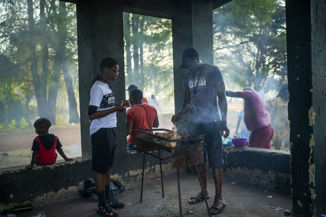 People celebrate South Africa's Heritage Day by cooking a barbecue at Zoo Lake park in Johannesburg Thursday September 24, 2020. As the number of worldwide Covid-19 death is nearing the million mark, coronavirus related case numbers and deaths in South Africa hit the lowest in months. (Photo by Jerome Delay/AP Photo)