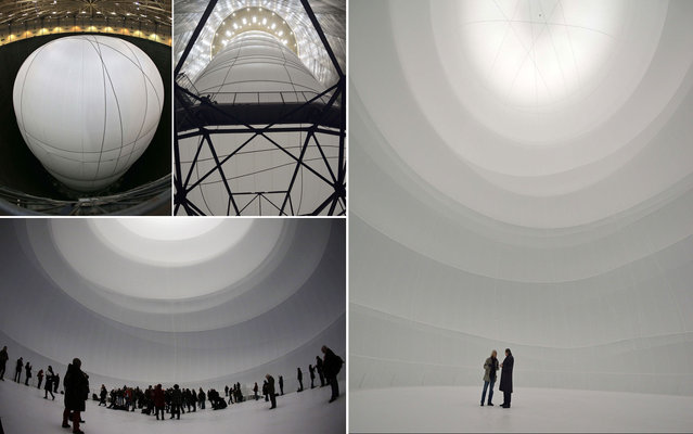 "US-Bulgarian artist Christo (R) during a press-visit in his installation ""Big Air Package"" on March 14, 2013 at the Oberhausen Casle in Oberhausen, western Germany. 18 years after the wrapping of the Reichstag and 14 years after the installation ""The Wall"" as the finale of the Emscher Park International Building Exhibition, Christo is returning to Germany with a further art project: From March 16 to December 30, 2013, Christo will fill the Oberhausen Gasometer with his Big Air Package. The artwork is the largest ever inflated frameless envelope and the largest indoor sculpture ever made. (Photo by Martin Meissner/AP Photo)"
