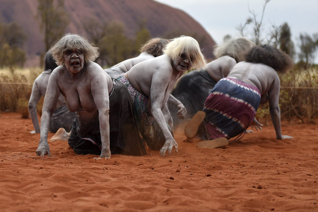 A picture made available on 26 October 2015 shows Aboriginal women performing a traditional dance at a cultural event near Uluru, also known as Ayres Rock, in the Northern Territory, Australia, 25 October 2015. Aboriginals marked on 26 October 2015, 30 years since the return of ownership of Uluru and Kata Tjuta from the Australian federal government. (Photo by Dan Peled/EPA)
