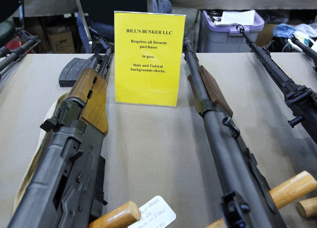 Most of the sellers at the Washington County Fairgrounds Gun Show are licensed dealers and require background checks before selling a firearm, on March 22, 2013. (Photo by Gary Porter)