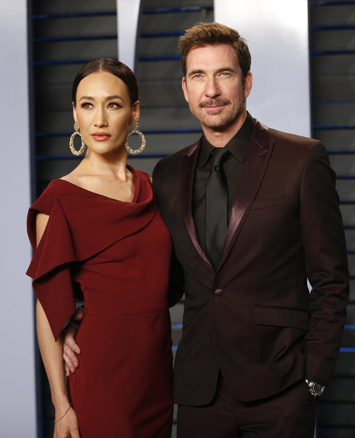 Dylan McDermott with actress Maggie Q attend the 2018 Vanity Fair Oscar Party hosted by Radhika Jones at the Wallis Annenberg Center for the Performing Arts on March 4, 2018 in Beverly Hills, California. (Photo by Danny Moloshok/Reuters)