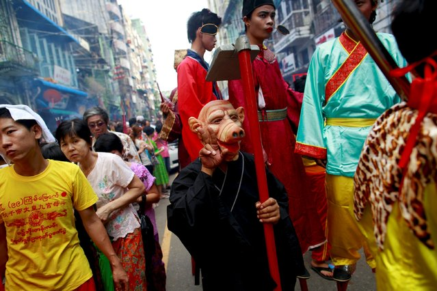 """A festival attendee, dressed as Zhu Bajie, a character from the Chinese novel """"Journey to the West"""", poses during a festival dedicated to Buddhist monk Shin Upagutta, celebrated by Myanmar's ethnic Chinese community in Chinatown, in Yangon October 21, 2015. (Photo by Soe Zeya Tun/Reuters)"""