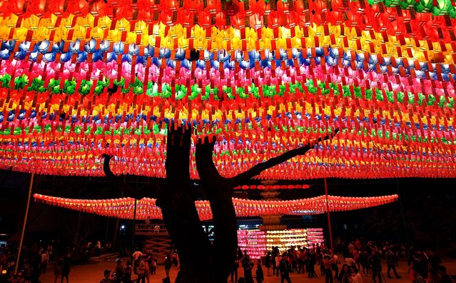 People walk under colorful lanterns as they celebrate the forthcoming birthday of Buddha at the Chogey temple in Seoul. (Photo by Chung Sung-Jun/Getty Images)