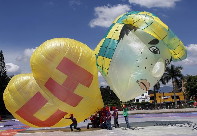 Balloons in tribute of comedian Roberto Gomez Bolanos are seen during the 14th Solar Balloon Festival in Envidago December 31, 2014. (Photo by Fredy Builes/Reuters)