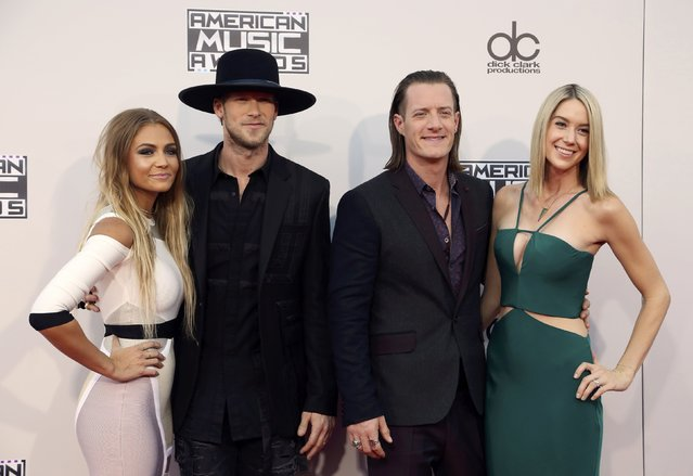 Florida Georgia Line duo Brian Kelley (2nd L) with his wife, Brittany Marie Cole and Tyler Hubbard with his wife, Hayley Stommel, arrive at the 2015 American Music Awards in Los Angeles, California November 22, 2015. (Photo by David McNew/Reuters)