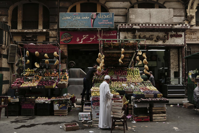 A fruit vendor waits for customers in Tawfiqia market in downtown Cairo, Egypt, Tuesday, October 18, 2016. Egypt's economy has been battered by unrest since the 2011 uprising that toppled longtime autocrat Hosni Mubarak. Inflation and unemployment are in double digits, and domestic and foreign debts are growing as Egypt's currency tumbles. (Photo by Nariman El-Mofty/AP Photo)