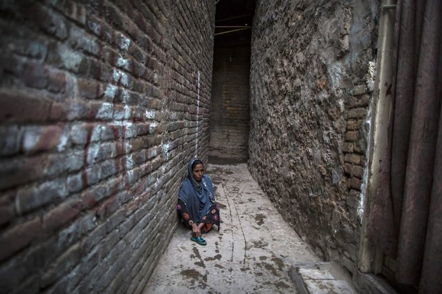 A handicapped woman is seen at a narrow alley at a slum in Islamabad January 6, 2015. (Photo by Zohra Bensemra/Reuters)
