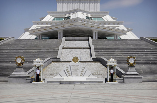 Soldiers stand at attention at the base of the Constitution Monument in Ashgabat. (Photo by Amos Chapple via The Atlantic)