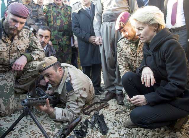 German Defence Minister Ursula von der Leyen (R) visits the Zeravani Training Centre in Bnaslava near Arbil, north of Iraq January 12, 2015, where Kurdish forces are being trained by the German army, Bundeswehr. (Photo by Maurizio Gambarini/Reuters)