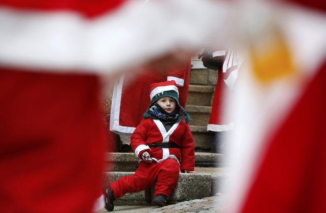 Three-year-old Lex dressed as Santa Claus takes part in the 22nd Santa Claus meeting in Auerbach, Germany, December 6, 2015. (Photo by Michaela Rehle/Reuters)