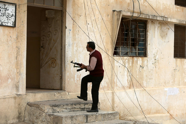 AÊYazidi man inspects a house in the town of Bashiqa, after it was recaptured from the Islamic State, east of Mosul, Iraq November 10, 2016. (Photo by Alaa Al-Marjani/Reuters)