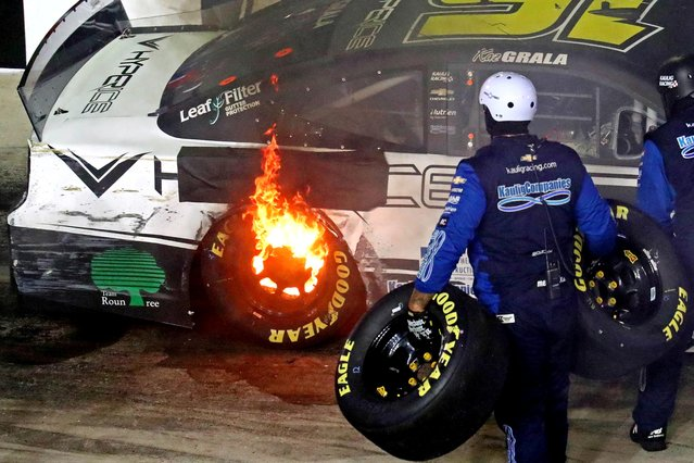 Kaz Grala, driver of the #16 Hyper Ice Chevrolet, pits with flams from his tire during the NASCAR Cup Series 63rd Annual Daytona 500 at Daytona International Speedway on February 14, 2021 in Daytona Beach, Florida. (Photo by Mark J. Rebilas/USA TODAY Sports)