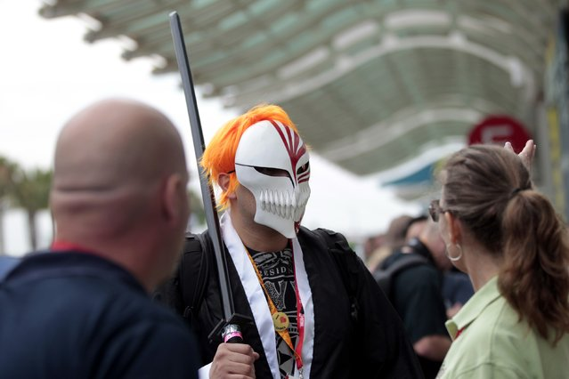"""A person dressed as the character """"Ichigo"""" from the Japanese manga and anime series Bleach is seen during the Comic-Con international convention in San Diego, California July 13, 2012. (Photo by Mario Anzuoni/Reuters)"""