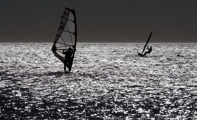Windsurfers enjoy the strong winds at Patacona beach in Valencia, Spain, 01 February 2021. Strong winds are expected throughout the day in Valencia. (Photo by Kai Foersterling/EPA/EFE)