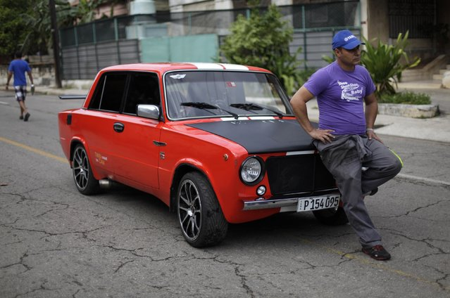David Pena poses for a photograph with his Lada 2101 built in 1979 on a street in Havana February 9, 2015. Getting parts from the United States is cheaper than in Cuba, where state-run stores sell them at four times the cost, said Pena, a mechanic and president of the Russian Car Club in Havana who drives a souped-up, sporty red 1972 Lada 2101 that he fixed himself. His own Lada has a Fiat engine and an extra Alfa Romeo carburetor. (Photo by Enrique De La Osa/Reuters)